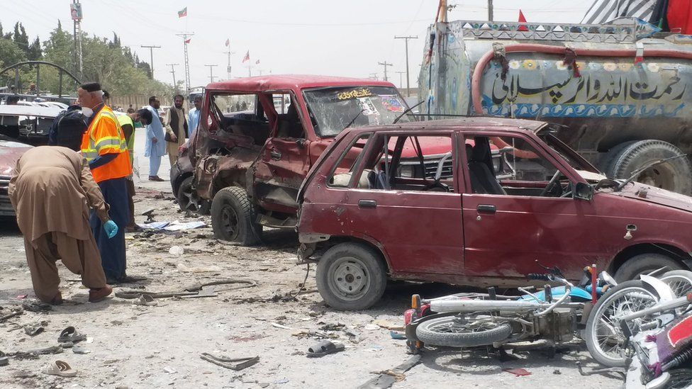 Pakistani security officials inspect the scene of a suspected suicide bomb attack outside a polling station in Quetta