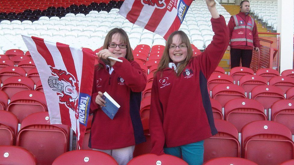 The girls at a Gloucester rugby game