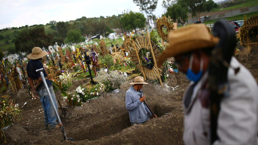 Cemetery workers dig new graves at the Xico cemetery on the outskirts of Mexico City