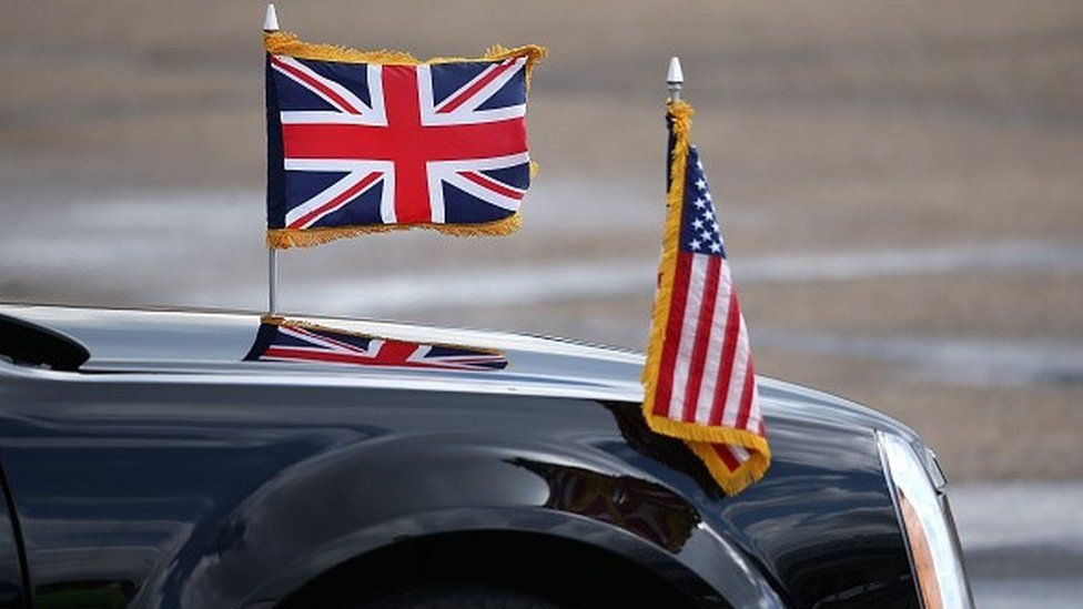 Car with UK and US flags