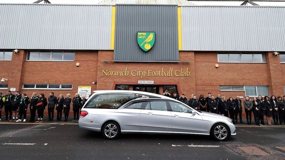 The funeral cortege was met outside Carrow Road by club staff and fans.