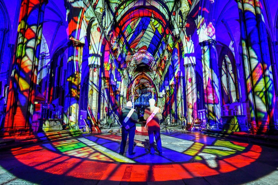 Ushers admire the interior of Salisbury Cathedral, 18 February 2020.