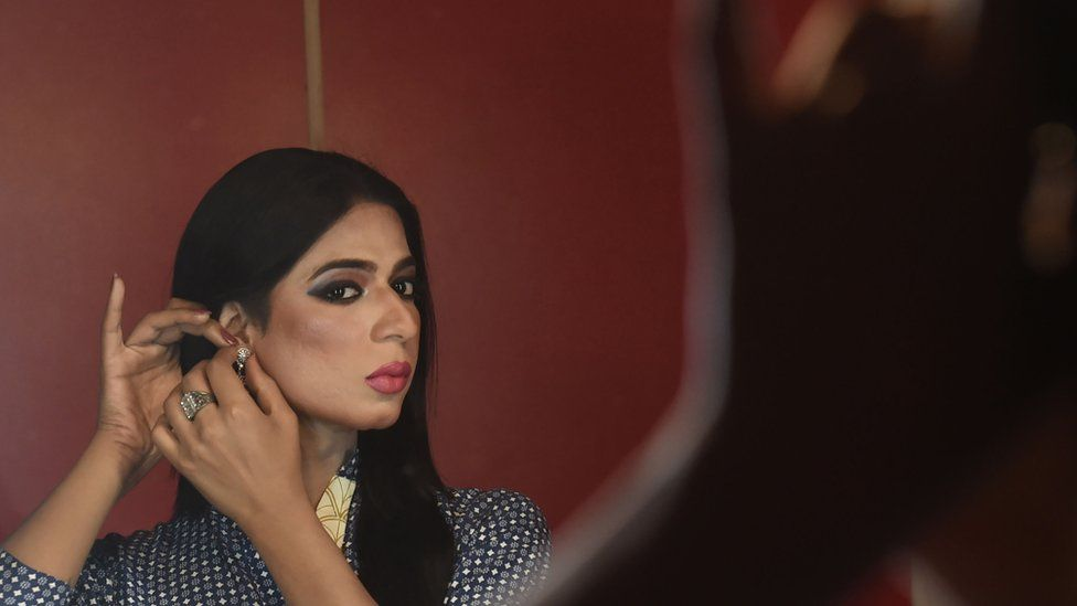 Pakistan's first transgender news anchor, Marvia Malik, prepares before going live to read the news for the private channel Kohenoor in Lahore, 27 March 2018