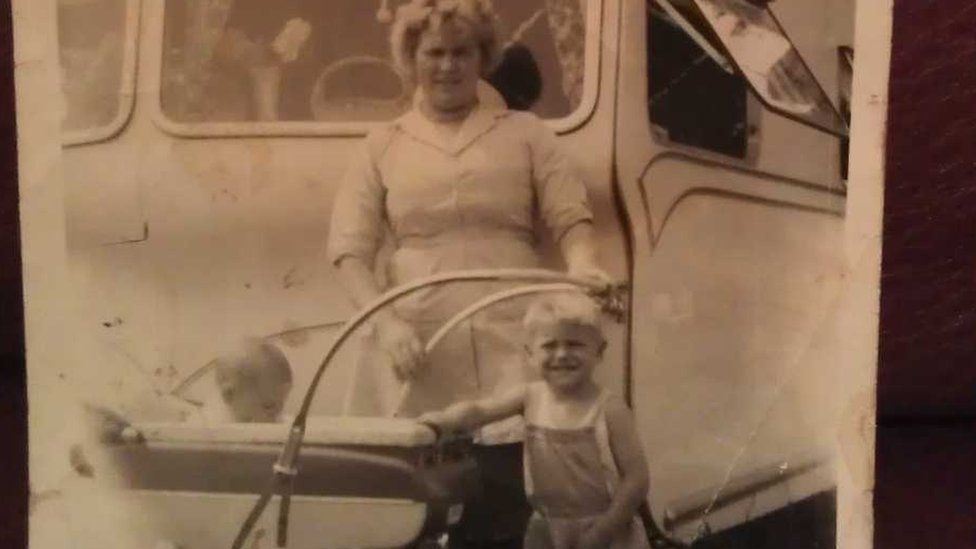 Larry as a young child with mum and brother outside their caravan