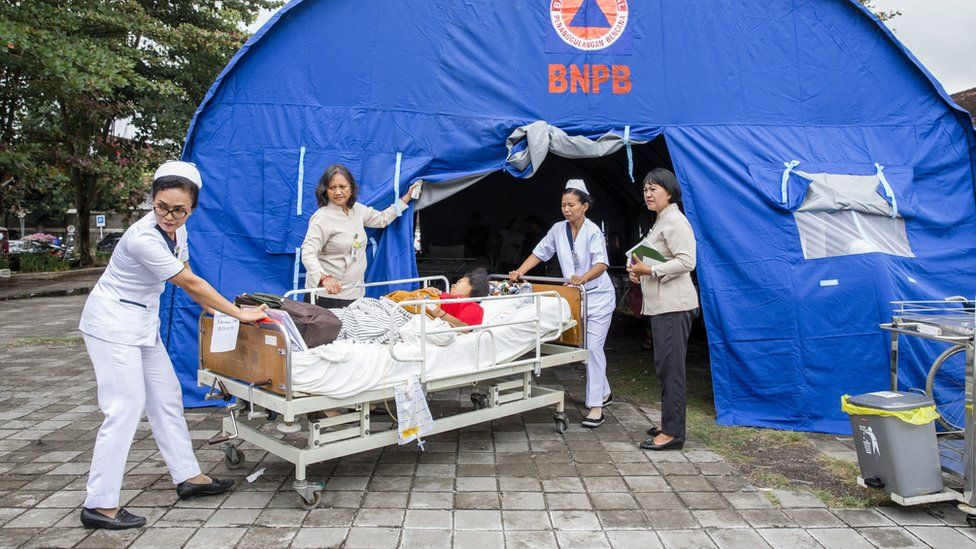 Hospital patients are moved to an emergency tent outside of a hospital building after an earthquake was felt in Denpasar, Bali, Indonesia, 06 August 2018