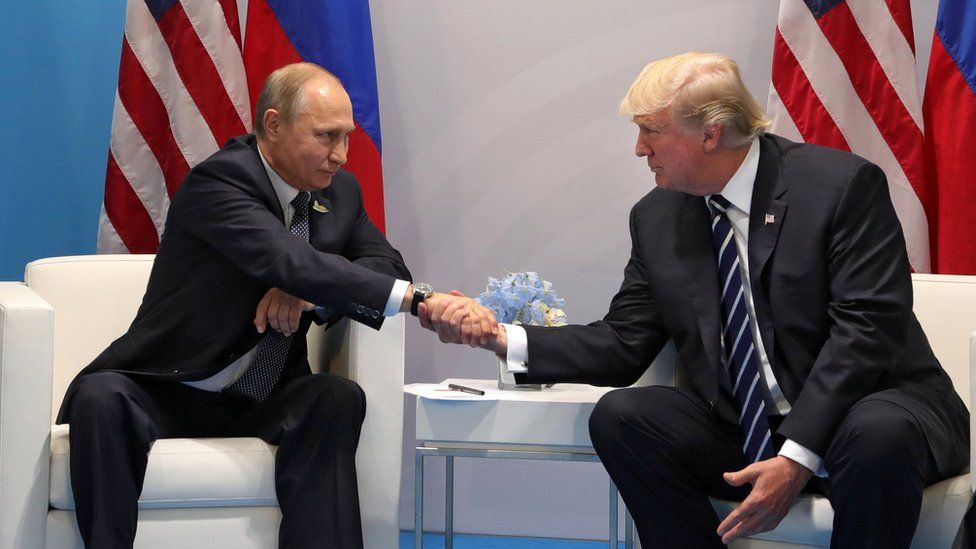 Russian President Vladimir Putin (L) and US President Donald Trump (R) shake hands during their meeting on the sidelines of the G20 summit in Hamburg, Germany (7 July 2017)