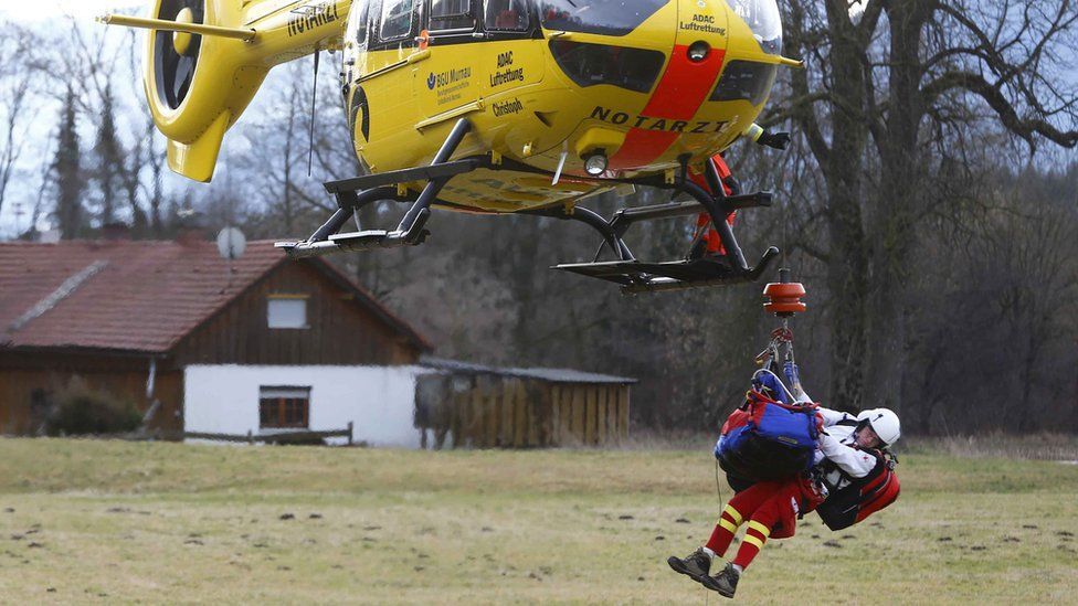 German rescue helicopter with an injured person underneath near the site. 9 Feb 2016