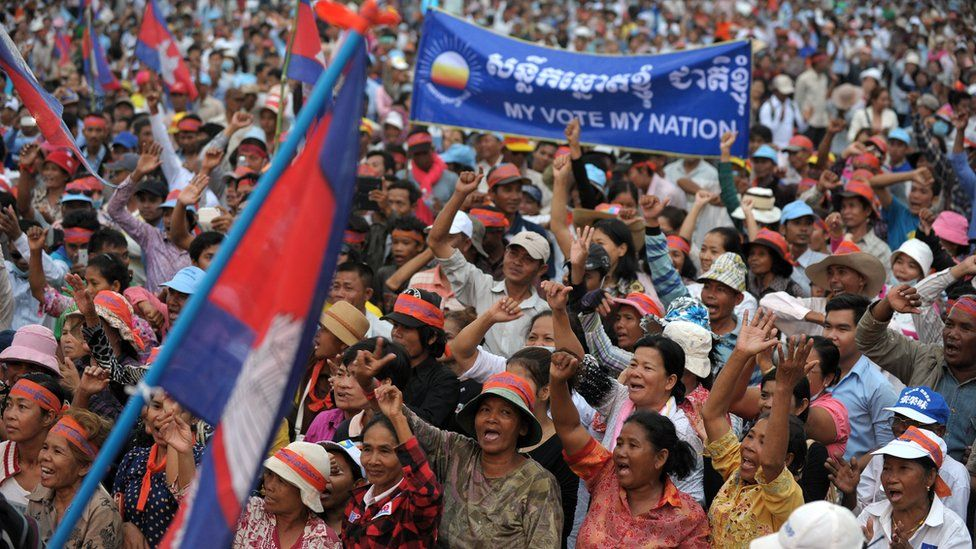 Supporters of the opposition Cambodia National Rescue Party (CNRP) shout slogans during a demonstration in Phnom Penh on December 16, 2013
