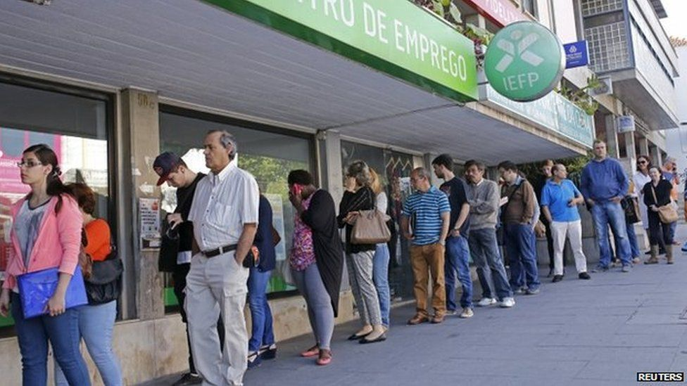 People wait at the employment centre to open in Sintra, Portugal