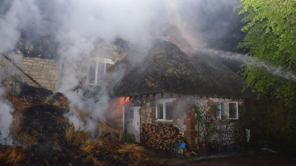 Thatched cottage fire