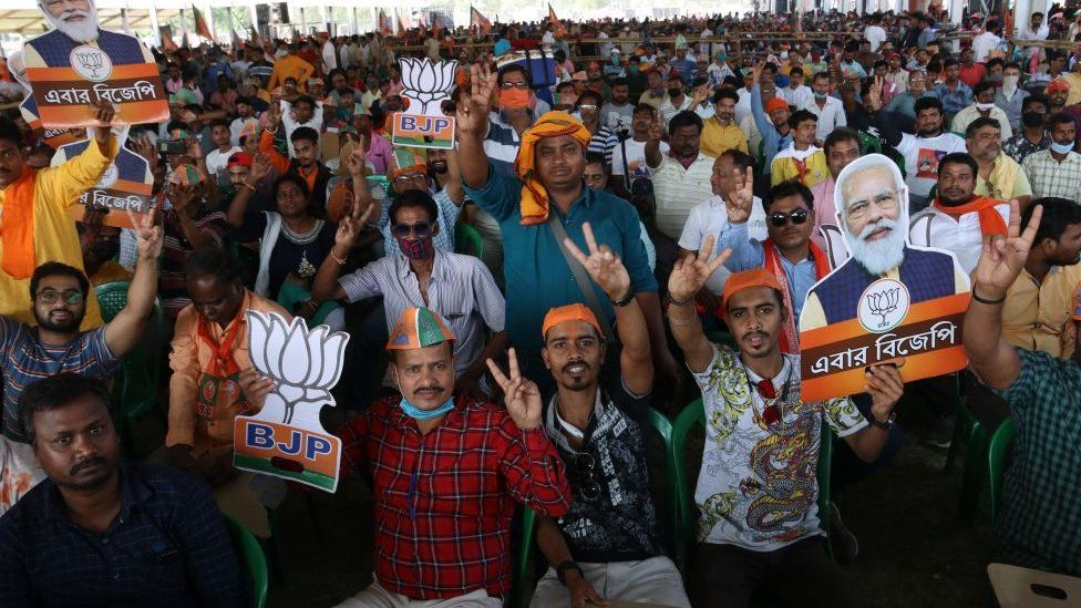 A crowd - mainly without masks - at a BJP rally