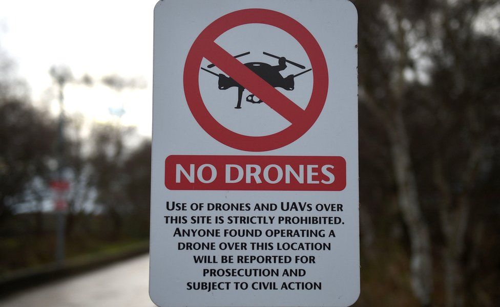 """A """"No Drones"""" sign alerting members of the public that the use of drones or unmanned aerial vehicles (UAV) is prohibited"""