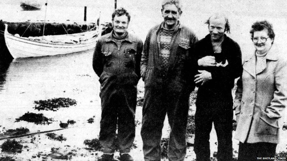 Coxswain Wilbert Clark, James Manson, Ove Joensen and his cat Jessica, and Carrie Manson pictured in Shetland in 1984