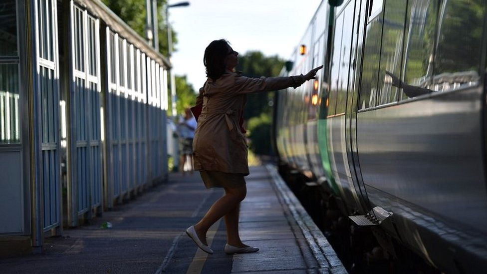 Woman boarding train at station