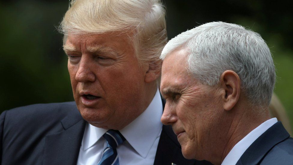 US President Donald Trump and Vice President Mike Pence at the Rose Garden of the White House in Washington