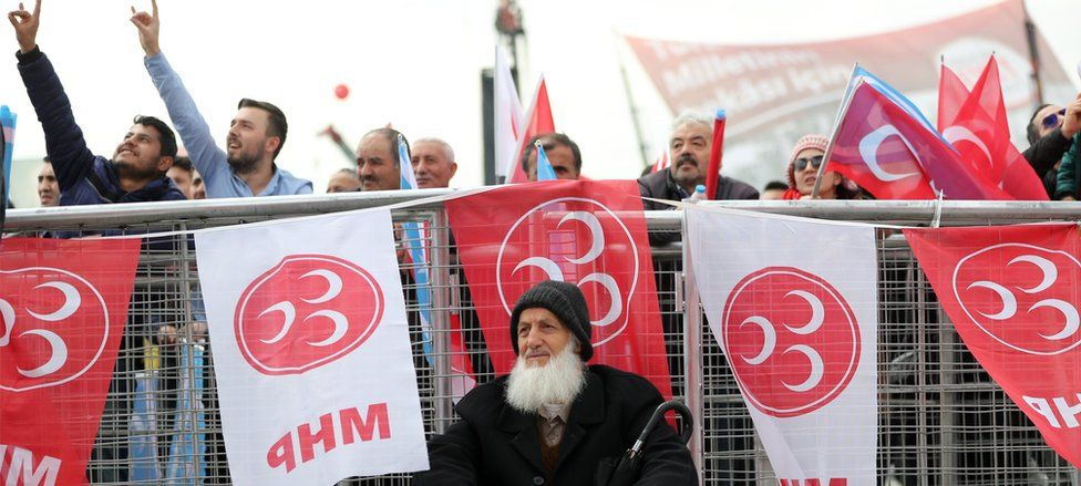 """Supporters of Nationalist Movement Party (MHP) chanting and making a wolf sign (sign of the Turkish Nationalists) during a """"Vote Yes"""" rally in Istanbul on 9 April"""
