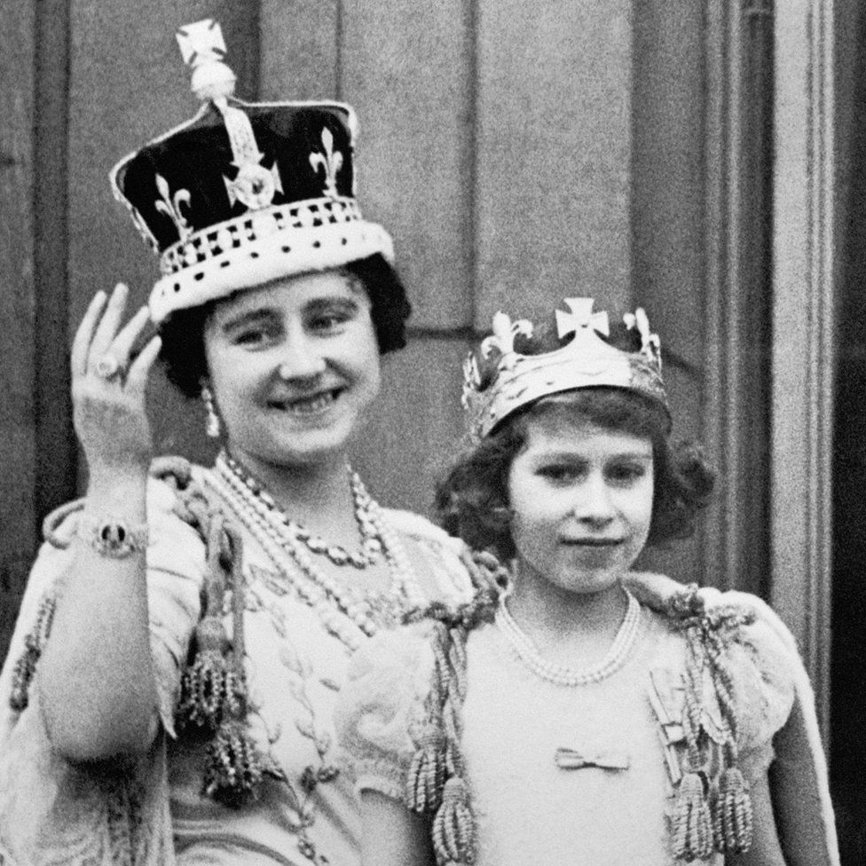 Queen Elizabeth (the Queen Mother) with her eldest daughter Princess Elizabeth on the balcony of Buckingham Palace, after the coronation of King George VI