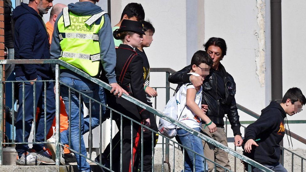 Students leave with their parents after being rescued from a hijacked bus in Milan, Italy, 20 March 2019