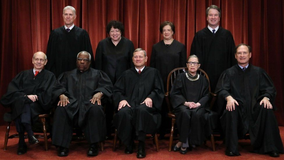 United States Supreme Court (Front L-R) Associate Justice Stephen Breyer, Associate Justice Clarence Thomas, Chief Justice John Roberts, Associate Justice Ruth Bader Ginsburg, Associate Justice Samuel Alito, Jr., (Back L-R) Associate Justice Neil Gorsuch, Associate Justice Sonia Sotomayor, Associate Justice Elena Kagan and Associate Justice Brett Kavanaugh pose for their official portrait at the in the East Conference Room at the Supreme Court building November 30, 2018 in Washington, DC