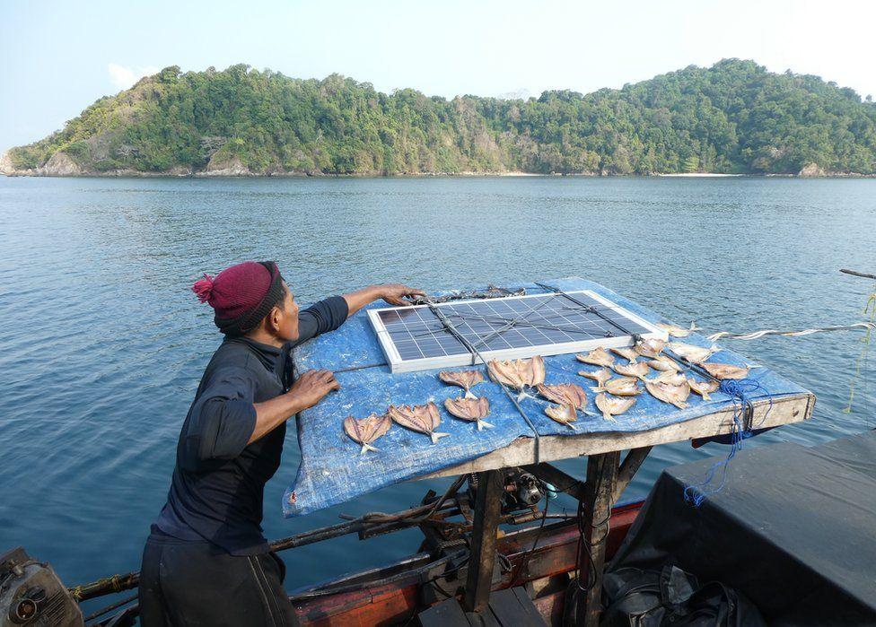 A man dries his fish