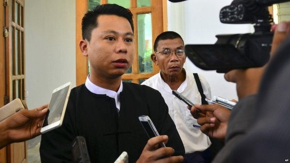 Arnt Khaung Min, deputy chief editor of the weekly Myanmar Herald, speaks to journalists as he leaves a township court in Naypyitaw, Myanmar, Tuesday, July 21, 2015.