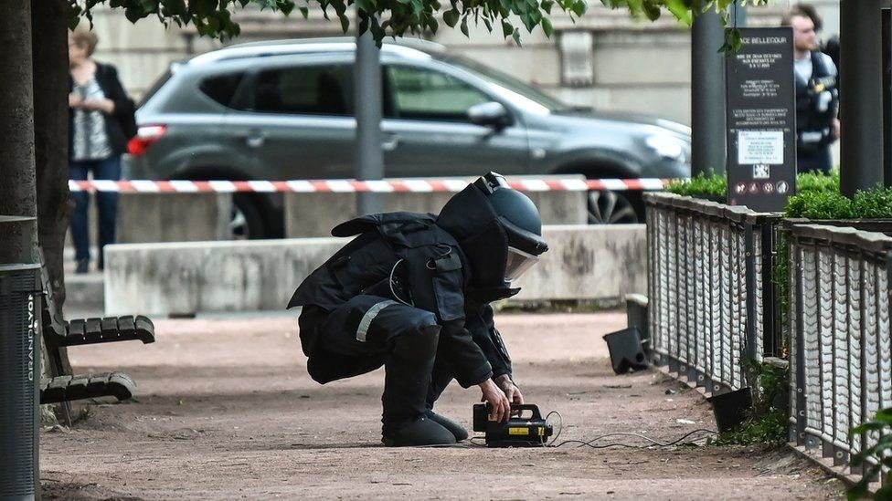 An explosives expert at work in Lyon, 24 May