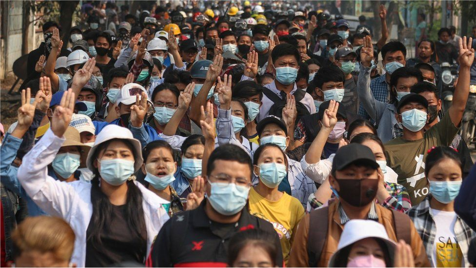 Demonstrators flash the three-finger salute during a protest against the military coup in Mandalay, Myanmar, 27 March 2021.