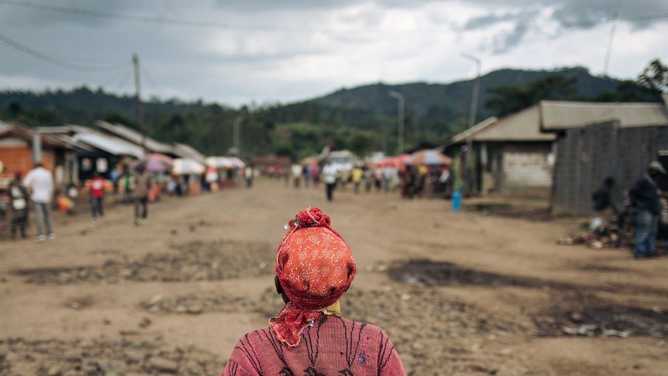 A woman crosses the Mweso market, Masisi Territory, eastern Democratic Republic of the Congo