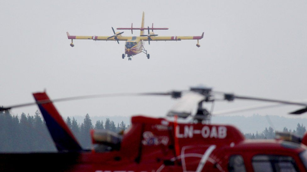 A French Bombardier 415 firefighting aircraft lands on the tarmac in Sveg, central Sweden on July 21, 2018 to help battle a 200 sq.km large wildfire that has been raging for more than a week