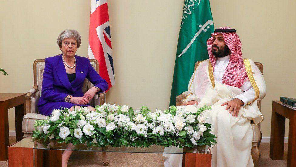 Britain's Prime Minister Theresa May and Saudi Crown Prince Mohammed bin Salman sit together during the Group 20 summit