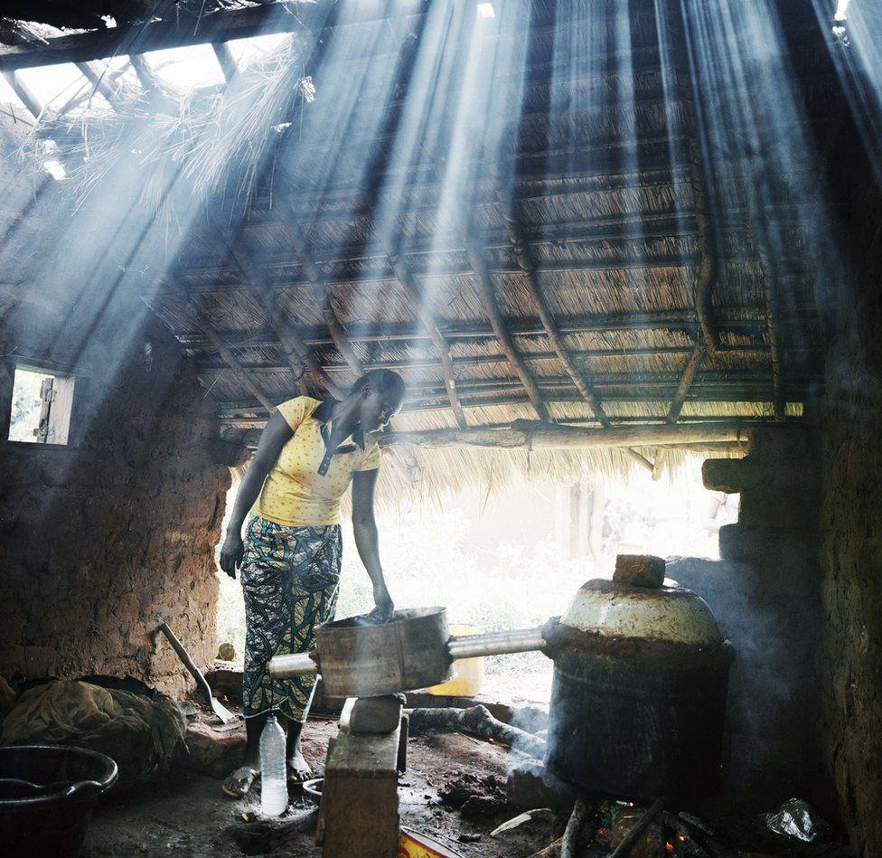 Light streams into a woman's house.