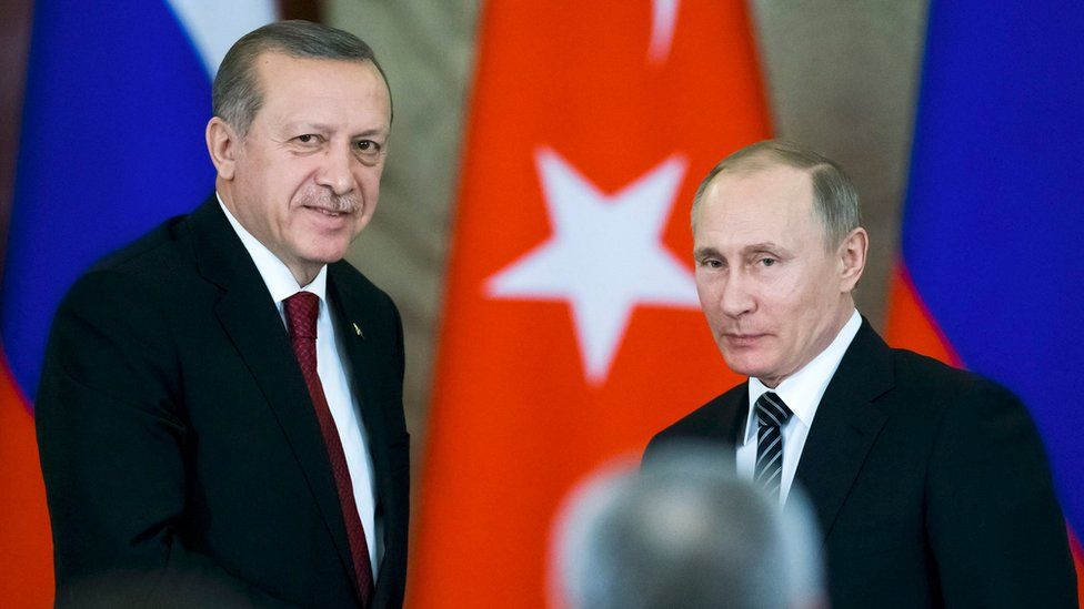 Russian President Vladimir Putin (R) shakes hands with his Turkish counterpart Recep Tayyip Erdogan after talks at the Kremlin in Moscow, Russia, on 10 March 2017