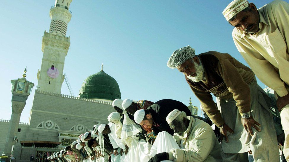 Pilgrims pray in the courtyard of the Prophet Mohammed Mosque in the holy Saudi city of Medina