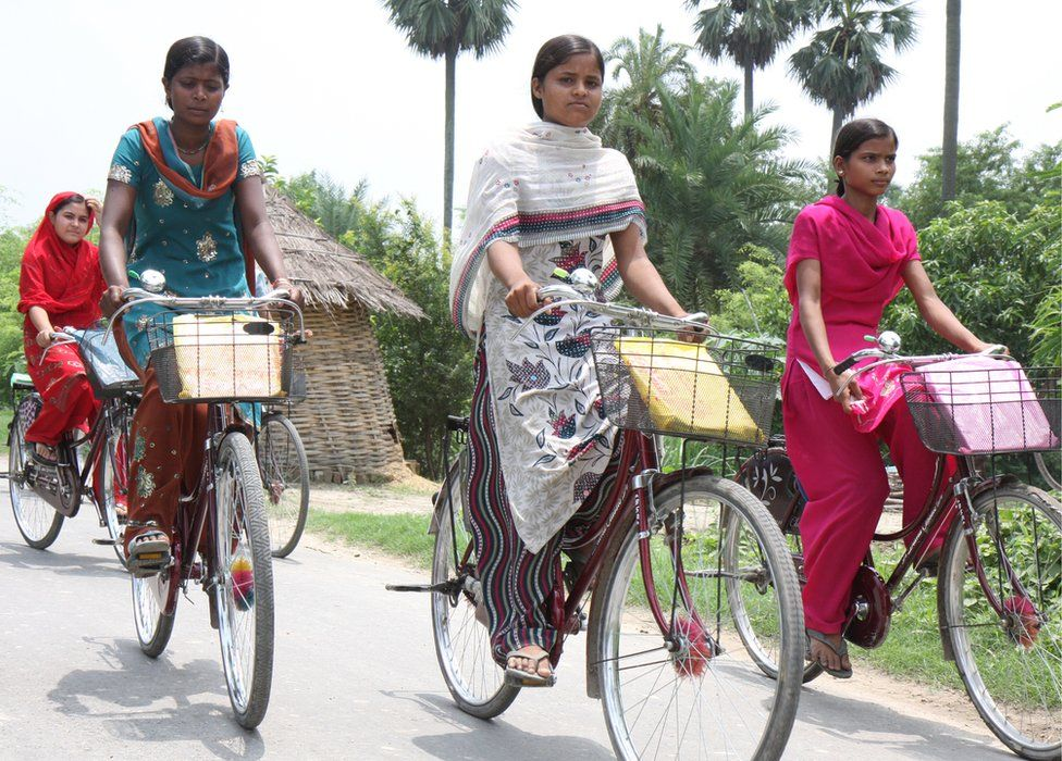 Girls cycle home from high school on bicycles provided by the Bihar state government
