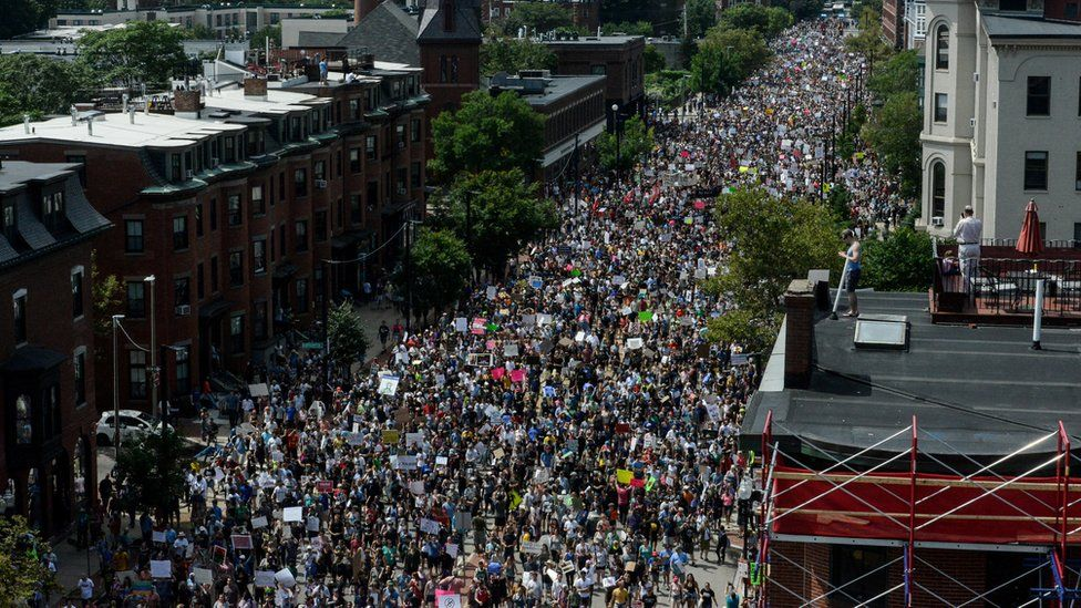 People march towards the Boston Commons to protest the Boston Free Speech Rally in Boston, 19 August 2017
