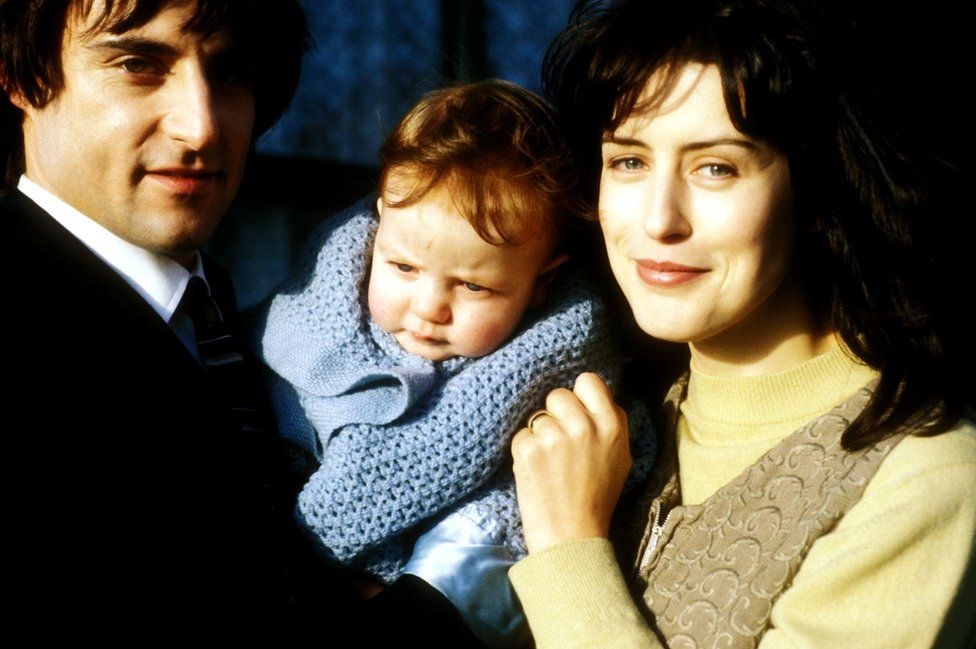 Mark Strong and Gina McKee with baby