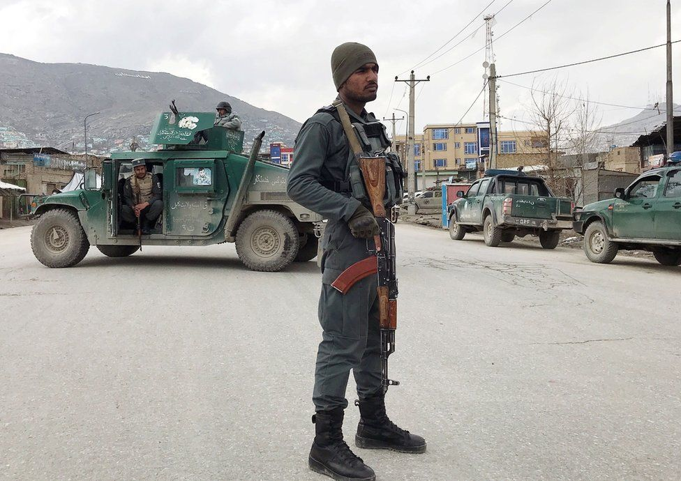 An Afghan policeman stands guard near the site of an attack in Kabul, Afghanistan March 25, 2020