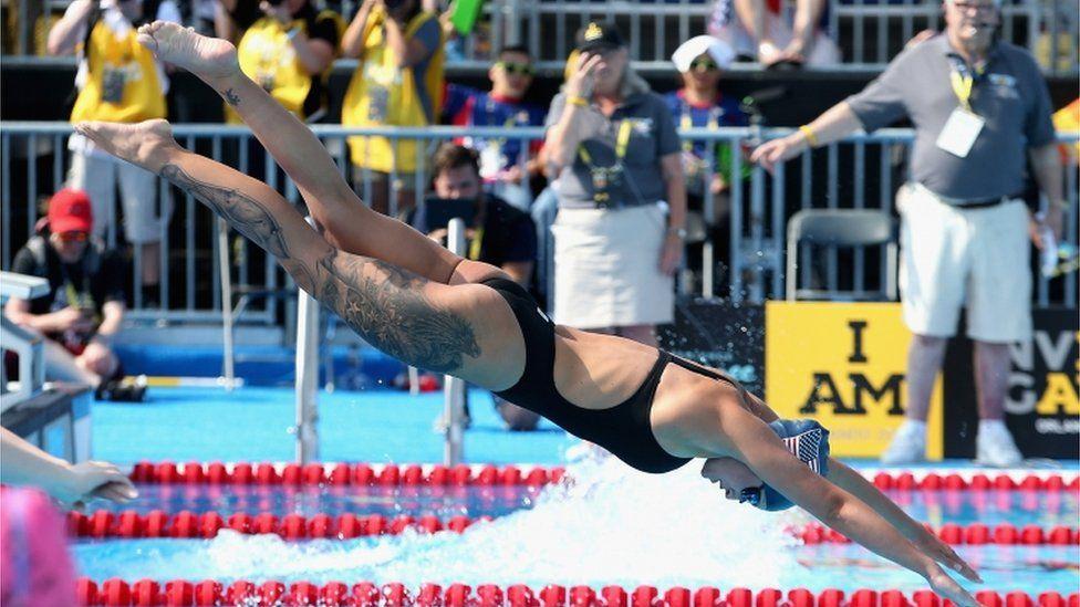 Elizabeth Marks dives into the pool
