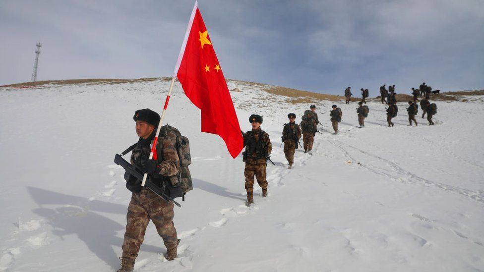Chinese troops march through the snow in Xinjiang