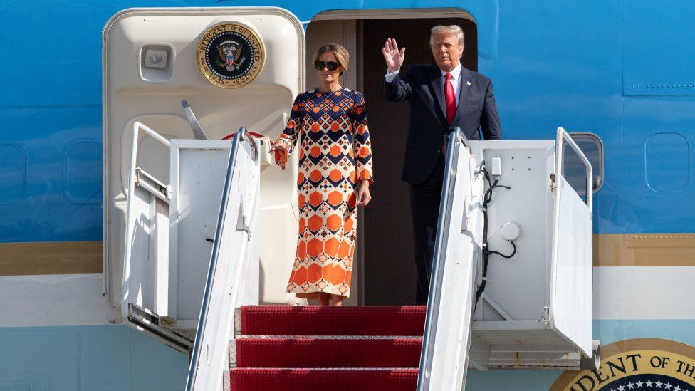 Donald Trump and Melania Trump exit Air Force One at the Palm Beach International Airport