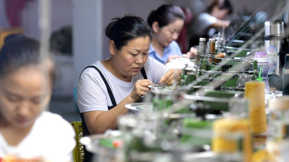 Women at sewing machines in China