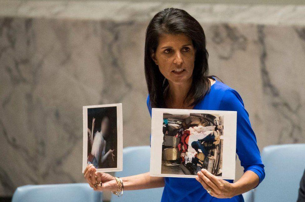 Nikki Haley hold photos of dead Syrian children
