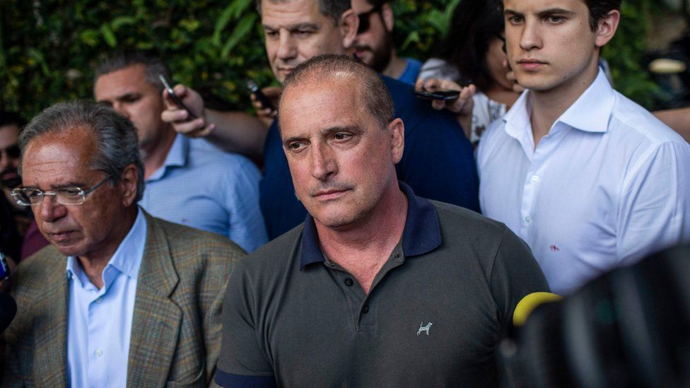 Onyx Lorenzoni (C), and Brazilian Economist Paulo Guedes (L) after a meeting with Jair Bolsonaro in Rio de Janeiro, Brazil, on October 30, 2018
