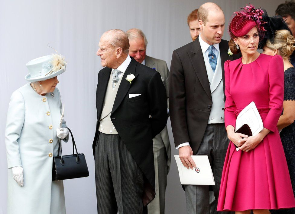 Queen Elizabeth, Prince Philip, Prince William and Kate, Duchess of Cambridge wait for the arrival by open carriage of Princess Eugenie