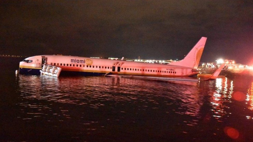 a Boeing 737 aircraft photographed side-on in river