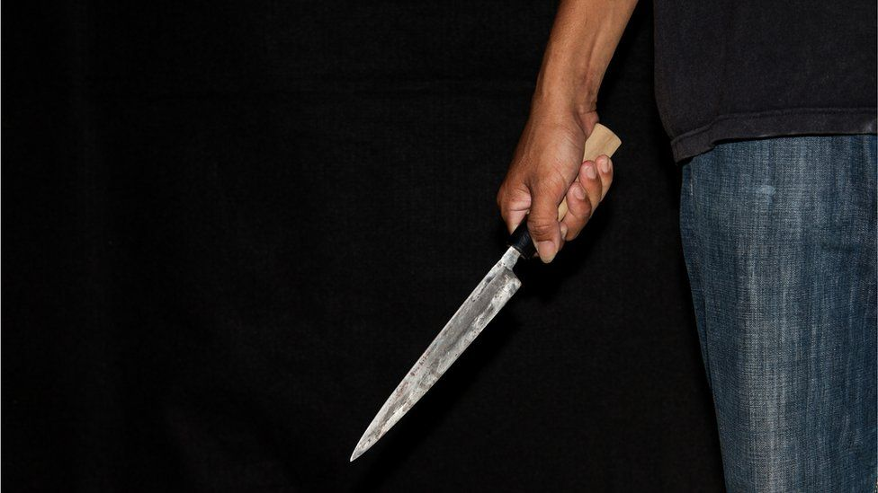 Stock image of a person with a knife