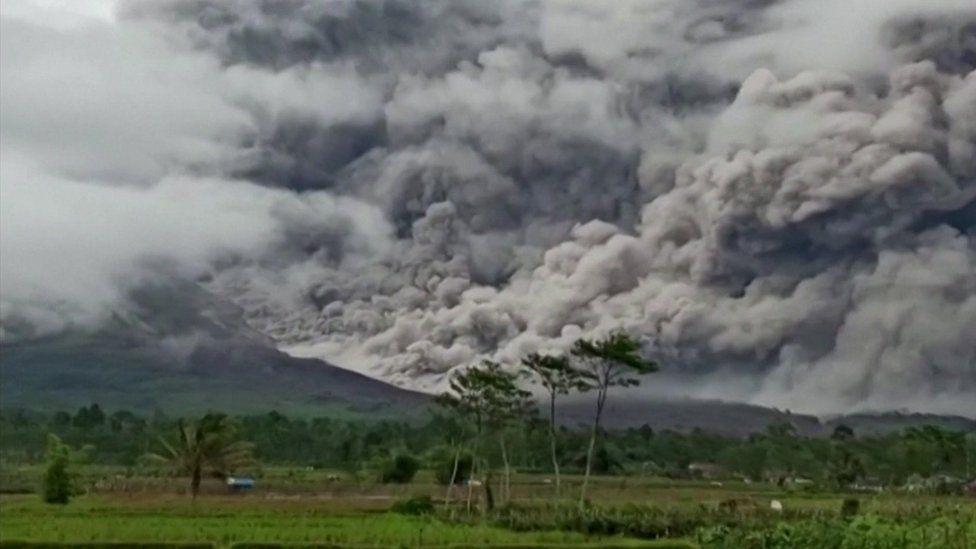 Huge clouds of ash rise from Mount Semeru