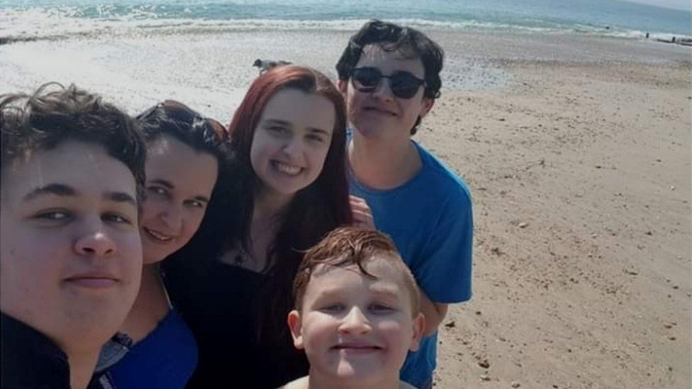 Jenni Lee and family on beach