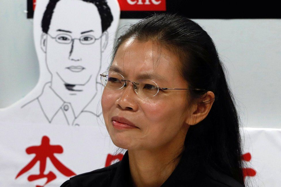 Lee Ching-yu, wife of Taiwan human rights advocate Lee Ming-che, who has been detained in China, speaks to the media a day before departing for her husband's trial, in Taipei, Taiwan 9 September 2017.