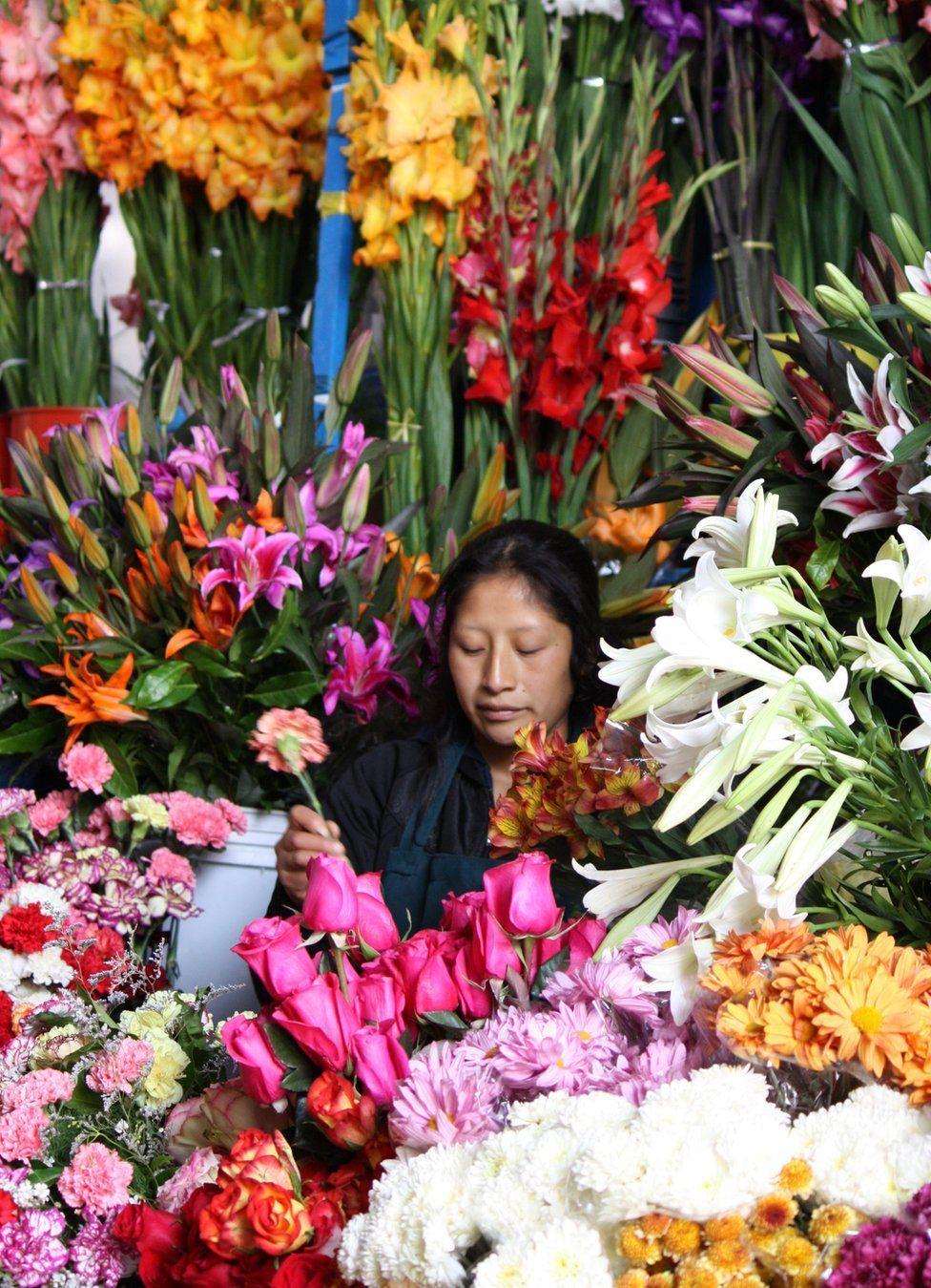 A flower seller amongst her flowers